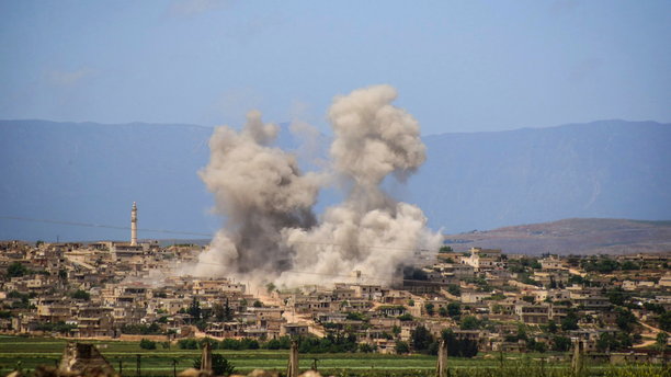 FILE - In this May 3, 2019 file photo, provided by the Syrian Civil Defense White Helmets, which has been authenticated based on its contents and other AP reporting, shows smoke rising after Syrian government and Russian airstrikes that hit the town of al-Habeet, southern Idlib, Syria. In their latest assault on the last rebel-stronghold of Idlib, the Syrian government and its Russian backer have resorted to familiar tactics to break the will of people and pressure civilians to flee: Target residential areas, bomb hospitals and markets, destroy civilian infrastructure. It is a well-established pattern that worked for President Bashar Assad's forces seeking to recapture Aleppo and other strategic rebel territories during the 8-year war. (Syrian Civil Defense White Helmets via AP, File)