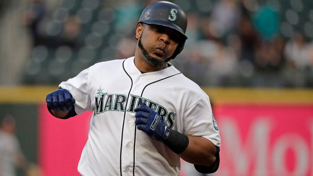 Seattle Mariners' Edwin Encarnacion rounds the bases after hitting a solo home run against the Houston Astros on June 3, 2019, in Seattle. (Associated Press)