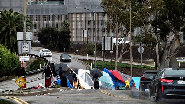 In this Jan. 14, 2019 file photo a homeless encampment is seen along a downtown Los Angeles.