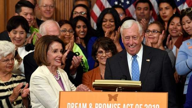 House Speaker Nancy Pelosi of Calif., front left, shakes hands with House Majority Leader Steny Hoyer, D-Md., during an event to support the American Dream and Promise Act. (AP Photo/Susan Walsh)