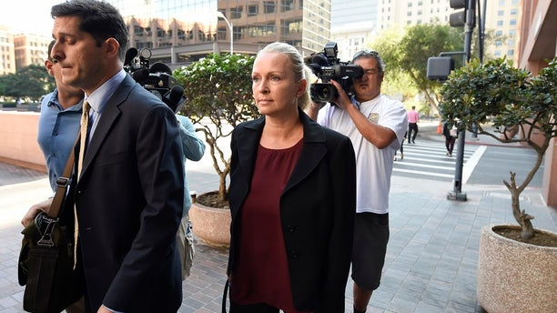 In this Thursday, Aug. 23, 2018, photo, Margaret Hunter, center, the wife of U.S. Rep. Duncan Hunter, arrives for an arraignment hearing in San Diego. (AP Photo/Denis Poroy)