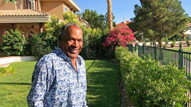 FILE: O.J. Simpson in the garden of his Las Vegas area home.