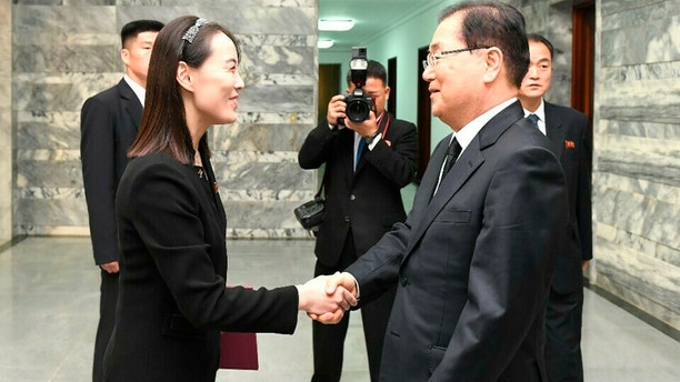 In this photo provided by South Korea Unification Ministry, North Korean leader Kim Jong Un's sister, Kim Yo Jong, shakes hands with South Korean presidential national security director Chung Eui-yong, right, at the northern side of the border village of Panmunjom in the Demilitarized Zone, South Korea.