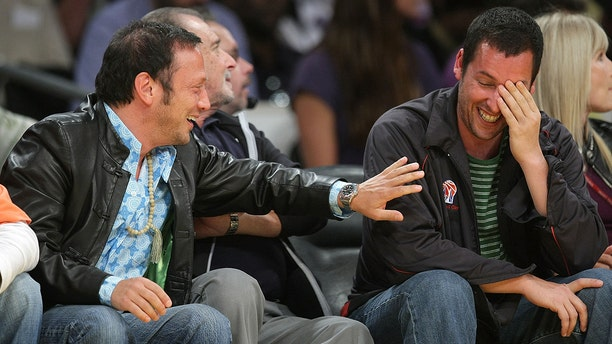 Rob Schneider, left, and Adam Sandler, right, attend Game Five of the Western Conference Semifinals during the 2009 NBA Playoffs at Staples Center on May 12, 2009 in Los Angeles, Calif. (Photo by Noel Vasquez/Getty Images)