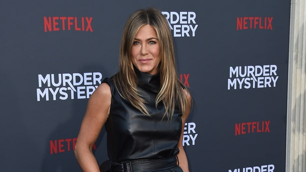 """Cast member Jennifer Aniston arrives at the Los Angeles premiere of """"Murder Mystery"""" at the Regency Village Theatre on Monday, June 10, 2019 in Westwood, Calif. (Photo by Jordan Strauss/Invision/AP)"""