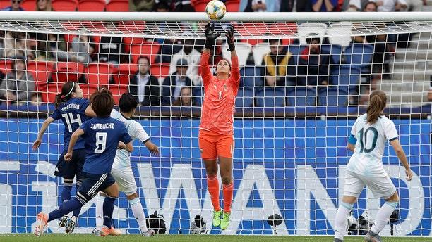 Argentina goalkeeper Vanina Correa, center, catching the ball. (AP Photo/Alessandra Tarantino)