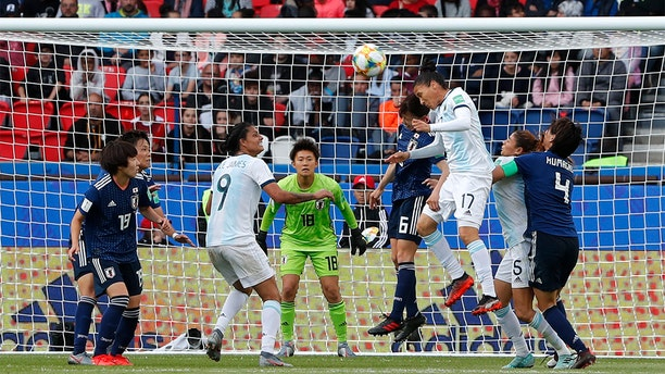 Argentina's Mariela Coronel, center right, and Japan's Hina Sugita fighting for the ball during the match. (AP Photo/Thibault Camus)