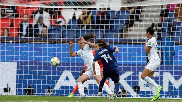 Japan's Yui Hasegawa, center, failing to score past Argentina's Florencia Bonsegundo during the Women's World Cup soccer match. (AP Photo/Alessandra Tarantino)