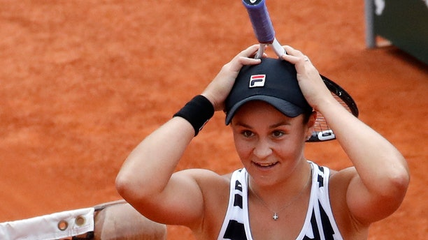 Australia's Ashleigh Barty celebrates winning her women's final match of the French Open tennis tournament against Marketa Vondrousova of the Czech Republic in two sets 6-1, 6-3, at the Roland Garros stadium in Paris, Saturday, June 8, 2019.