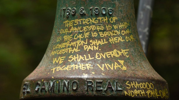 A detailed view of graffiti on an El Camino Real bell marker located at UC Santa Cruz is shown before being officially removed on Friday, June 21, 2019, in Santa Cruz, Calif. (AP Photo/Cody Glenn)