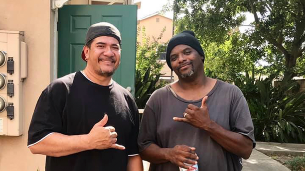 This photo released Tuesday, June 11, 2019, by the Stockton Police Department shows John Pedebone, left, and Troy Cooper, who rescued an abandoned baby in a building's dumpster in Stockton, Calif. The Stockton Police Department says the boy was found wrapped in a plastic bag Tuesday afternoon in Stockton, south of Sacramento. Cooper was unable to get into the dumpster so he called on-site manager Pedebone to rescue the baby. (Stockton Police Department via AP)