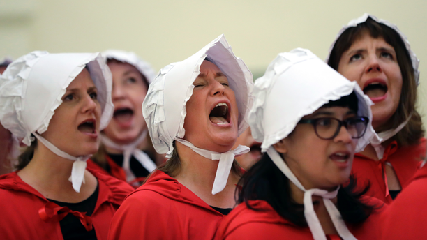"In this May 2017 photo, activists dressed as characters from ""The Handmaid's Tale"" chanted in the Texas Capitol Rotunda protesting SB8, a bill requiring health care facilities, including hospitals and abortion clinics, to bury or cremate any fetal remains whether from abortion, miscarriage or stillbirth. (AP Photo/Eric Gay, File)"