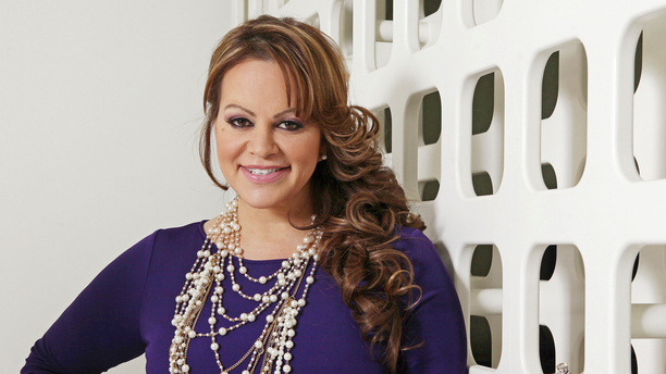 FILE - In this March 8, 2012, file photo, Mexican-American singer and reality TV star Jenni Rivera poses during an interview in Los Angeles. Jenni Rivera Enterprises said Tuesday, June 18, 2019, that it has partnered with production companies Mucho Mas Media and De Line Pictures to develop a film based on Rivera's life. Rivera died in December 2012 in a plane crash, at age 43. (AP Photo/Reed Saxon, File)