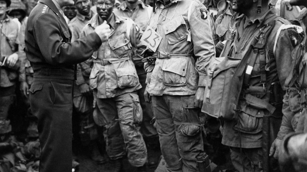 FILE -- June 6, 1944: U.S. Gen. Dwight D. Eisenhower, left, gives the order of the day to paratroopers in England prior to boarding their planes to participate in the first assault of the Normandy invasion. (U.S. Army Signal Corps via AP)