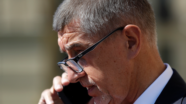 Czech Republic's Prime Minister Andrej Babis speaks on the phone waiting for arrival of Myanmar's State Counselor Aung San Suu Kyi at the government's headquarters in Prague, Czech Republic, Monday, June 3, 2019. (AP Photo/Petr David Josek)