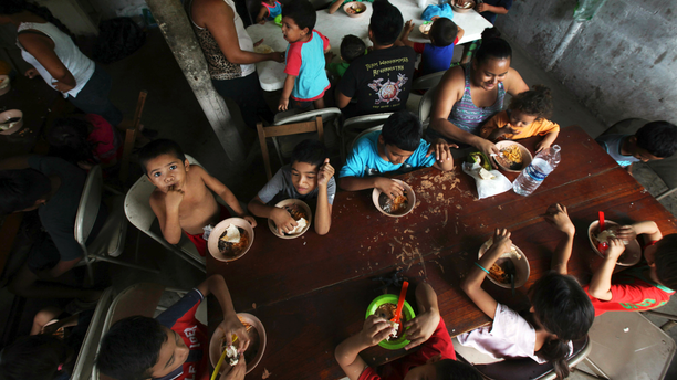 FILE - In this May 30, 2019 file photo, Honduran migrant children eat a meal at the Jesus el Buen Pastor del Pobre y el Migrante shelter in Tapachula, Chiapas state, Mexico. The federal government will be opening a facility at an Army base in Oklahoma to house migrant children and is considering a customs port in southern New Mexico as another option as existing shelters are overwhelmed. The Office of Refugee Resettlement said Tuesday, June 11, 2019 it's dealing with a dramatic spike in the number of children crossing the border without parents. (AP Photo/Marco Ugarte, File)