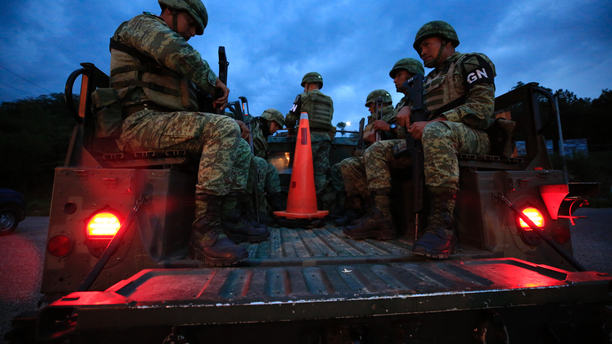 Soldiers forming part of Mexico's National Guard board a truck to patrol back roads used to circumvent a migration checkpoint, in Comitan, Chiapas state, Mexico, Saturday, June 15, 2019. Under pressure from the U.S. to slow the flow of migrants north, Mexico plans to deploy thousands of National Guard troops by Tuesday to its southern border region. (AP Photo/Rebecca Blackwell)