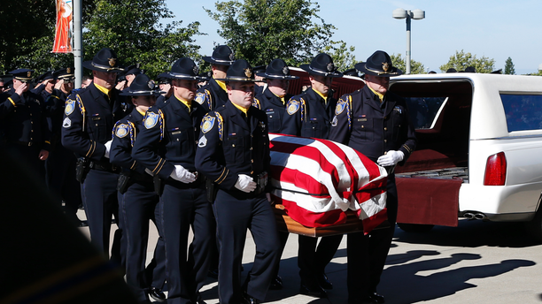 The flag-draped casket of Sacramento Police Officer Tara O'Sullivan is carried into the Bayside Adventure Church for memorial services in Roseville, Calif., Thursday, June 27, 2019. O'Sullivan was shot and killed responding to a domestic violence call.