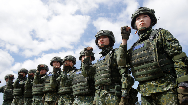 FILE - In this May 30, 2019, file photo, the first team of Taiwan artillerywomen poses for the press during the annual Han Kuang exercises in Pingtung County, Southern Taiwan. Taiwan has confirmed Thursday, June 6, 2019, that it has asked to purchase more than 100 U.S. tanks, along with air defense and anti-tank missile systems in a major potential arms sale that could worsen frictions between Washington and Beijing. (AP Photo/Chiang Ying-ying, File)