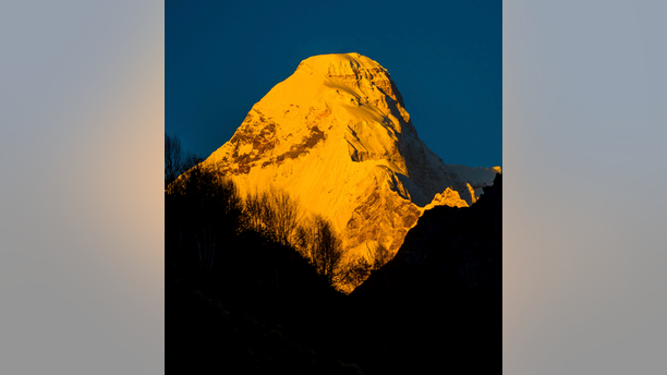 In this Oct. 8, 2016, photograph provided by Juniper Outdoor Pursuits Centre Pvt. Ltd., shows early morning light falling on Nanda Devi east base peak, seen from Pachu valley in Uttarakhand, India. Indian air force pilots have resumed a search over a Himalayan mountain for a team of mostly foreign climbers missing since late May. The fourth day of the search on Tuesday was taking place in the northern state of Uttarakhand after five bodies were spotted in the snow in high-resolution photos taken Monday. (Maninder Kohli/Juniper Outdoor Pursuits Centre Pvt. Ltd. via AP)