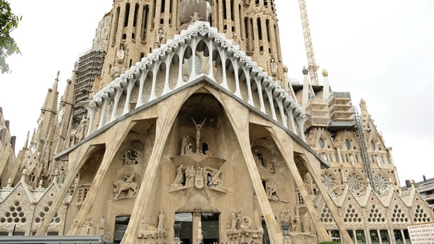 FILE - In this Sunday, Aug. 20, 2017 file photo, dignitaries leave after a Mass at Barcelona's Sagrada Familia Basilica for the victims of the terror attacks, in Barcelona, Spain. Barcelona's breathtaking La Sagrada Familia Basilica designed by architect Antoni Gaudi has finally received its official construction permit over 130 since the placement of its first stone. Barcelona's town hall announced on Friday, June 7, 2019 that after negotiations with the church's builders it had granted them a work permit through 2026. (AP Photo/Manu Fernandez, file)