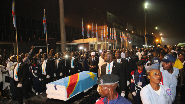The coffin carrying the remains of longtime Congolese opposition leader Etienne Tshisekedi arrives at Kinshasa airport Thursday, May 30, 2019. The body of Tshisekedi, father of the current Congolese President Felix Tshisekedi, died in Brussels in February 2017, was returned to home soil Thursday night for burial more than two years after his death, after a political standoff ended. (AP Photo/John Bompengo)