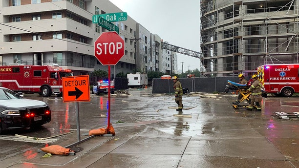 The crane fell into a downtown apartment building Sunday afternoon as strong winds, heavy rain and hail battered parts of North Texas. (Jordan Grinnell)