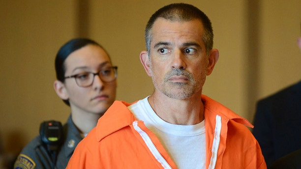 Fotis Dulos stands during a hearing at Stamford Superior Court, Tuesday9 in Stamford, Conn. Fotis Dulos, and his girlfriend, Michelle Troconis, have been charged with evidence tampering and hindering prosecution in the disappearance of his wife, Jennifer Dulos. The mother of five has has been missing since May 24.