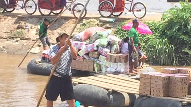 Dozens of rafts cross the Suchiate River carrying locals mostly shopping in Mexico for food, beer and appliances. They take the rafts to avoid tariffs on the bridge and customs officials.