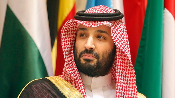 Saudi Crown Prince Mohammed bin Salman poses during a group picture ahead of Islamic Summit of the Organization of Islamic Cooperation in Mecca, Saudi Arabia, in June. His country is trying to execute an 18-year-old who was arrested when he was 13, reports say.