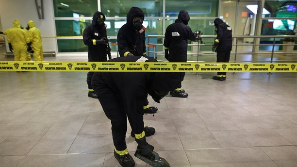 A Hazmat team conducting checks inside Kuala Lumpur International Airport after the killing of Kim Jong Nam in 2017. (Mat Zain/NurPhoto via Getty Images)