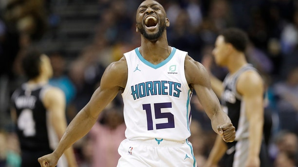 The Lakers are reportedly interested in Walker. (AP Photo/Chuck Burton, File)