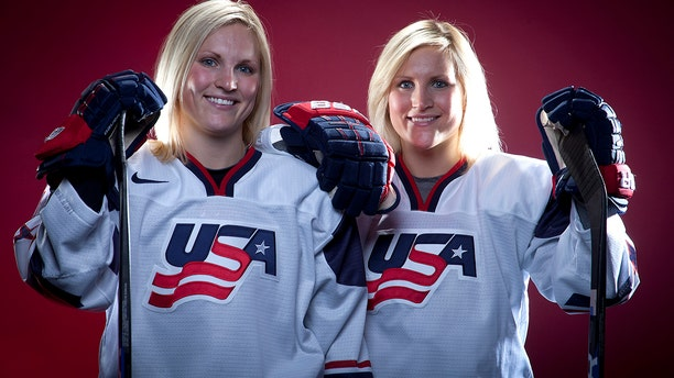 FILE - In this Oct. 2, 2013, file photo, United States Olympic Winter Games Hockey players Jocelyne Lamoureux, left, and Monique Lamoureux pose for a portrait at the Team USA Media Summit in Park City, Utah. (AP Photo/Carlo Allegri, File)