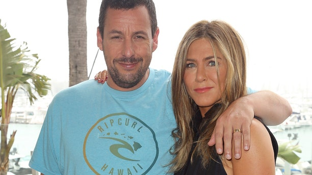 """Adam Sandler, left, and Jennifer Aniston attend the """"Murder Mystery"""" photo call at the Ritz-Carlton Marina del Rey on Tuesday, June 11, 2019, in Los Angeles. (Photo by Willy Sanjuan/Invision/AP)"""
