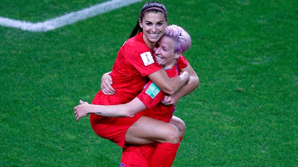 United States' Megan Rapinoe, right, congratulates teammate Alex Morgan after scoring her fifth goal during the Women's World Cup Group F soccer match between the United States and Thailand at the Stade Auguste-Delaune in Reims, France, Tuesday, June 11, 2019. (AP Photo/Francois Mori)