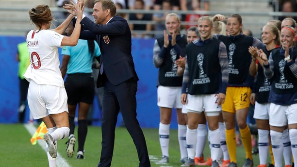 Norway's Caroline Graham Hansen, left, is congratulated by Norway coach Martin Sjogren after scoring her team's first goal during the Women's World Cup Group A soccer match between Norway and South Korea at the Stade Auguste-Delaune in Reims, France, Monday, June 17, 2019. (AP Photo/Alessandra Tarantino)