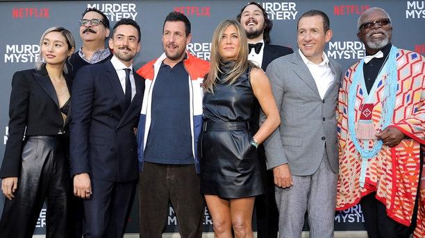 "(L-R) Shiori Kutsuna, Erik Griffin, Luis Gerardo Mendez, Adam Sandler, Jennifer Aniston, Kyle Newacheck, Dany Boon and Dr. John Kani attend the Netflix World Premiere of ""Murder Mystery"" at Village Theatre Westwood on June 10, 2019 in Los Angeles, Calif."