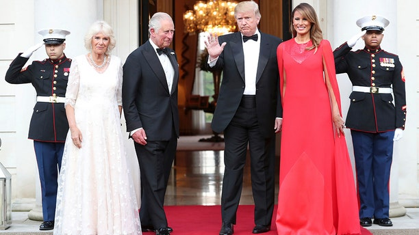 President Trump and first lady Melania Trump greet Britain's Prince Charles and Camilla, the Duchess of Cornwall, outside Winfield House, the residence of the Ambassador of the United States of America to the UK, in Regent's Park, London, on June 4, 2019. (Chris Jackson/Pool Photo via AP)