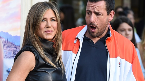"""Cast members Jennifer Aniston and Adam Sandler arrive at the Los Angeles premiere of """"Murder Mystery"""" at the Regency Village Theatre on Monday, June 10, 2019 in Westwood, Calif. (Photo by Jordan Strauss/Invision/AP)"""