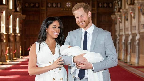 Britain's Prince Harry and Meghan, Duchess of Sussex, during a photocall with their newborn son, in St George's Hall at Windsor Castle, Windsor, on May 8, 2019.  (Dominic Lipinski/Pool via AP)