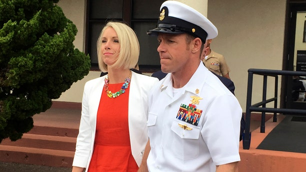 Navy Special Operations Chief Edward Gallagher leaves a military courtroom on Naval Base San Diego with his wife, Andrea Gallagher, on Thursday, in San Diego. (AP)