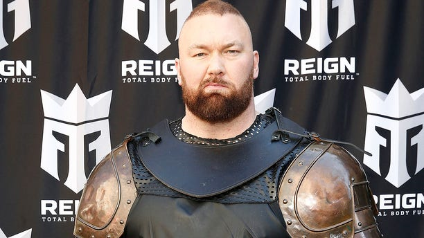 """""""Game of Thrones"""" actor Hafþór Júlíus Björnsson (Thor) """"The Mountain"""" leads a march through the streets of Times Square to celebrate the launch of Monster Energy's new performance beverage REIGN Total Body Fuel on April 16, 2019. He's out to defend his World's Strongest Man title following the """"Game of Thrones"""" series finale."""