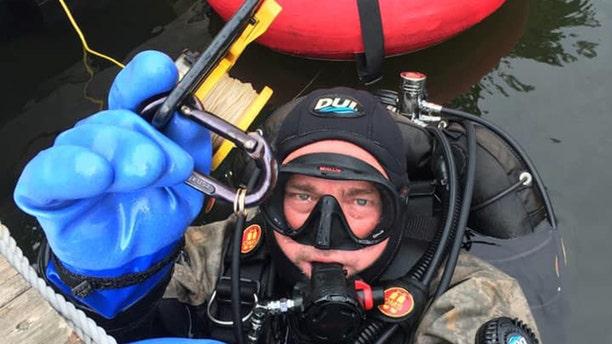 Dive Lt. Rich Slidgerski found a woman's missing wedding ring in 18 feet of water in Lake Wallenpaupack in Pennsylvania.