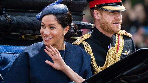 Prince Harry, Duke of Sussex and Meghan, Duchess of Sussex ride by carriage down the Mall during Trooping The Colour on June 8, 2019 in London. (Photo by Samir Hussein/Samir Hussein/WireImage)