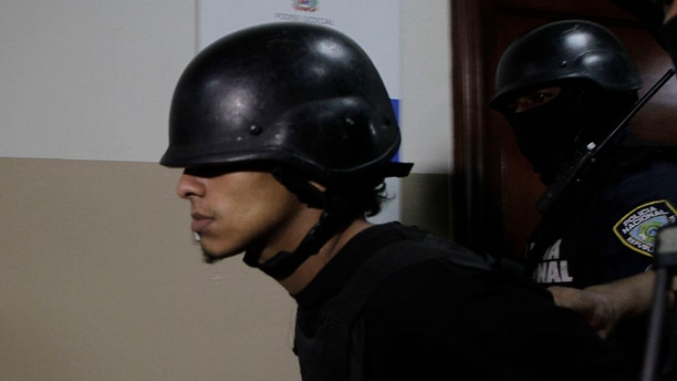 Rolfy Ferreyra Cruz, a suspect in connection with the shooting of former Boston Red Sox slugger David Ortiz, is taken to court by police in Santo Domingo, Dominican Republic, Friday, June 14, 2019. Ortiz was shot in the back at a bar in the Dominican Republic on Sunday, June 9. (AP Photo/Roberto Guzman)