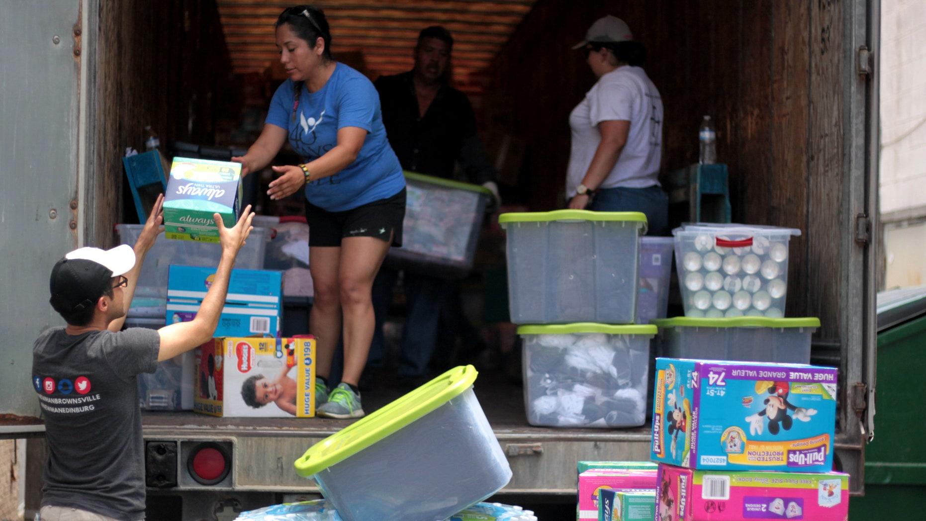 Volunteers unloading the truck of supplies at respite center in McAllen, Texas.