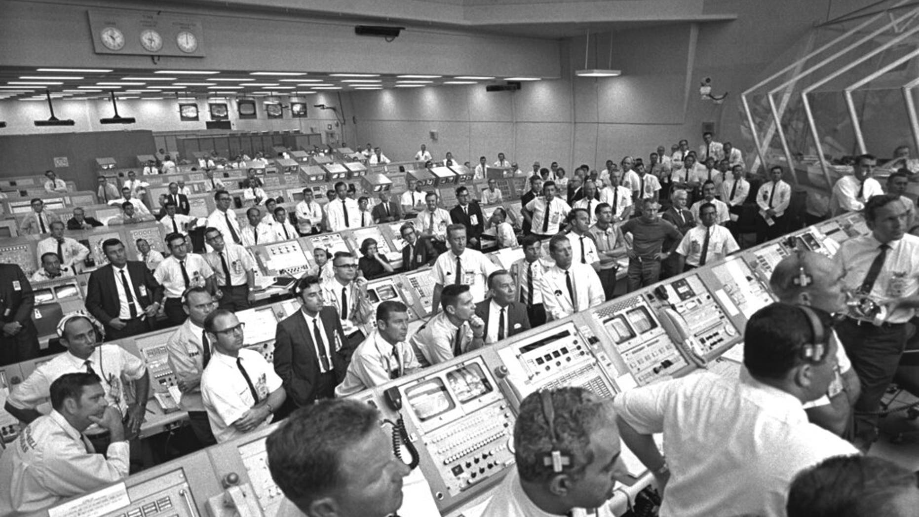 """This July 1969 photo provided by NASA shows launch controllers in the firing room at the Kennedy Space Center in Florida during the Apollo 11 mission to the moon. In the third row from foreground at center is JoAnn Morgan, the first female launch controller. """"I was there. I wasn't going anywhere. I had a real passion for it,"""" Morgan said in a July 2019 interview. """"Finally, 99 percent of them accepted that 'JoAnn's here and we're stuck with her.' """" (NASA via AP)"""