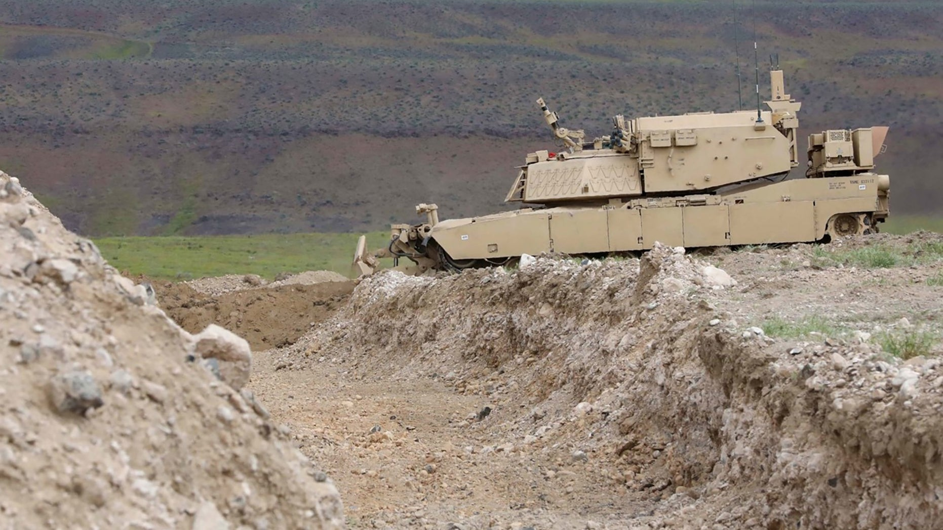 A remote-controlled concept assault breacher vehicle prepares to breach an obstacle during field testing at the Joint Warfighting Assessment 19, April 28, 2019.