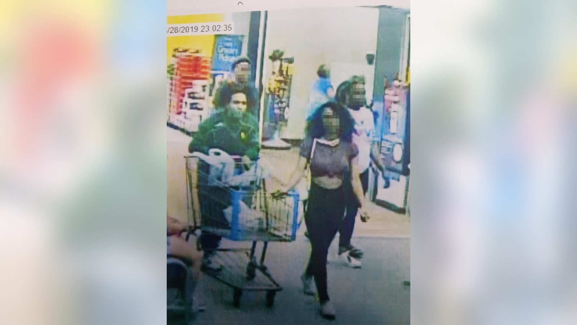 """Still from store video showing the suspected """"Blue Bell Licker"""" and her boyfriend. The girl, a juvenile whose name has not been released, has been identified by Lufkin, Texas police as the person who licked a tub of ice cream in a Walmart store then put it back in the freezer. """