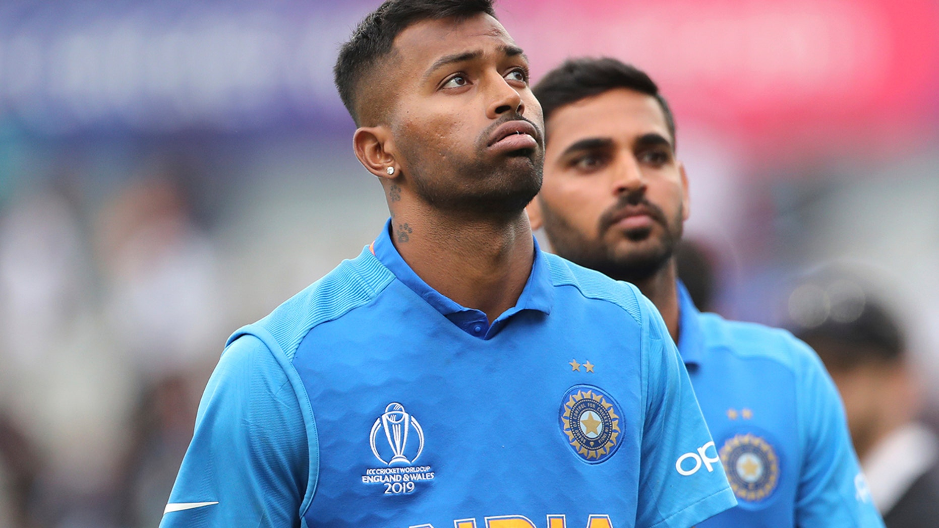 India's Hardik Pandya, left, reacts after their loss in the Cricket World Cup semi-final match against New Zealand at Old Trafford in Manchester, England, Wednesday, July 10, 2019. (AP Photo/Aijaz Rahi)